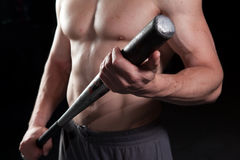 Shirtless guy holding a baseball bat. Torso of a shirtless guy holding a baseball bat Stock Photography