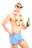 Shirtless guy holding a bottle of beer Stock Images