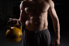 Shirtless guy holding a dumbbell Stock Images
