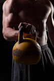 Shirtless guy holding a dumbbell. Torso of a shirtless guy holding a dumbbell Royalty Free Stock Photo