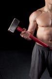 Shirtless guy holding a sledgehammer. Torso of a shirtless guy holding a sledgehammer Stock Images