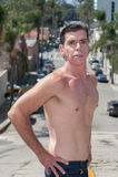 Shirtless guy stopping traffic. Royalty Free Stock Photos