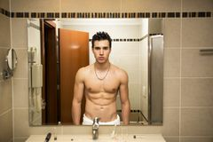 Shirtless handsome young man in bathroom Royalty Free Stock Image