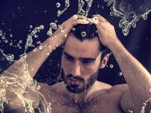 Shirtless young man with water splashes Royalty Free Stock Photo