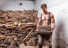 Shirtless lumberjack with an axe stock image