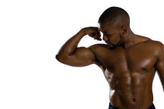Shirtless male athlete flexing muscles Royalty Free Stock Photography