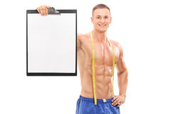 Shirtless male athlete holding a clipboard. Isolated on white background Stock Images