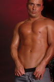 Shirtless male on brown Royalty Free Stock Photo