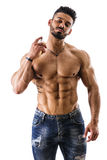 Shirtless male model spraying cologne Stock Images
