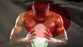 Shirtless male rugby player holding ball and screaming. Digital composite of handsome shirtless African American male rugby player holding rugby ball and