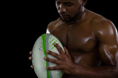 Shirtless male rugby player holding ball Royalty Free Stock Photos