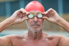 Shirtless male swimmer wearing swimming goggles. Close up of shirtless male swimmer wearing swimming goggles Stock Photo