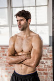 Shirtless man with arms crossed Stock Images