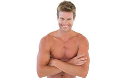Shirtless man with arms crossed Stock Photo