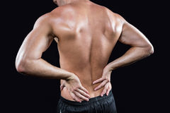 Shirtless man with back pain Stock Photography