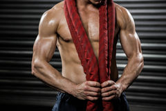 Shirtless man with battle rope around neck royalty free stock image