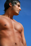 Shirtless man on the beach Royalty Free Stock Images