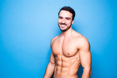 Shirtless man with beard on blue. Background royalty free stock images
