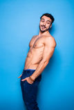 Shirtless man with beard on blue background Royalty Free Stock Image