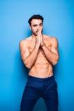 Shirtless man with beard on blue background stock photos