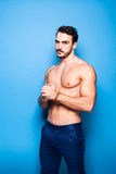 Shirtless man with beard on blue background Stock Photo