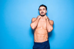 Shirtless man with beard on blue background Royalty Free Stock Photography