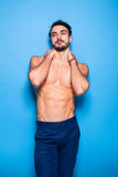 Shirtless man with beard on blue background Royalty Free Stock Photos