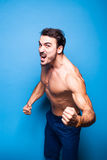 Shirtless man with beard on blue background Stock Photos