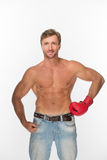 Shirtless man with a boxing glove over white Royalty Free Stock Image
