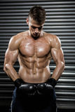 Shirtless man with boxing gloves Royalty Free Stock Image