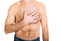 Shirtless man with chest pain Stock Images