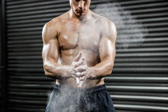 Shirtless man clapping hands with talc Stock Photography