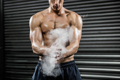 Shirtless man clapping hands with talc stock photos
