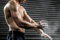 Shirtless man clapping hands with talc stock images