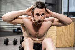 Shirtless man doing abdominal crunches royalty free stock image