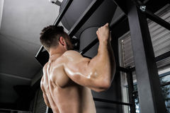 Shirtless man doing pull up Stock Photo
