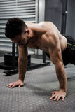 Shirtless man doing push up. At the crossfit gym Stock Photo