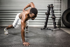 Shirtless man doing push up. At the crossfit gym Royalty Free Stock Photography
