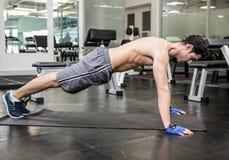 Shirtless man doing push up. At the gym Royalty Free Stock Photo