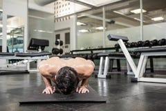 Shirtless man doing push up. At the gym Royalty Free Stock Image