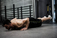 Shirtless man doing push up with the rope Royalty Free Stock Images