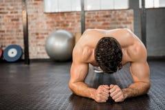 Shirtless man doing push ups Stock Images