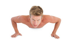 Shirtless man doing push ups Stock Images