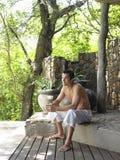 Shirtless Man Enjoying The View On Terrace. Young shirtless man on terrace enjoying the view Stock Photo