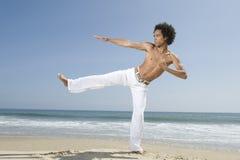 Shirtless Man Exercising On Beach Royalty Free Stock Image