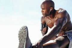 Shirtless man exercising outdoors Stock Image