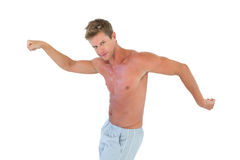 Shirtless man gesturing and showing his muscles Stock Photography