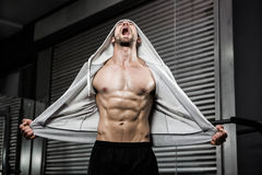 Shirtless man with grey jumper shouting. At the crossfit gym Royalty Free Stock Images