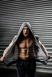 Shirtless man with grey jumper shouting Royalty Free Stock Images