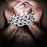 Shirtless man with his hands chained Stock Photography